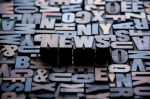 The word News written out in old letterpress printing blocks